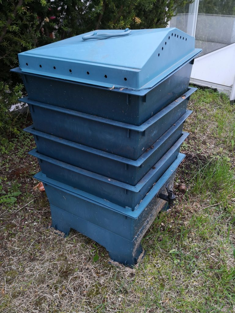 Photo of a worm factory 360 staged compost bin