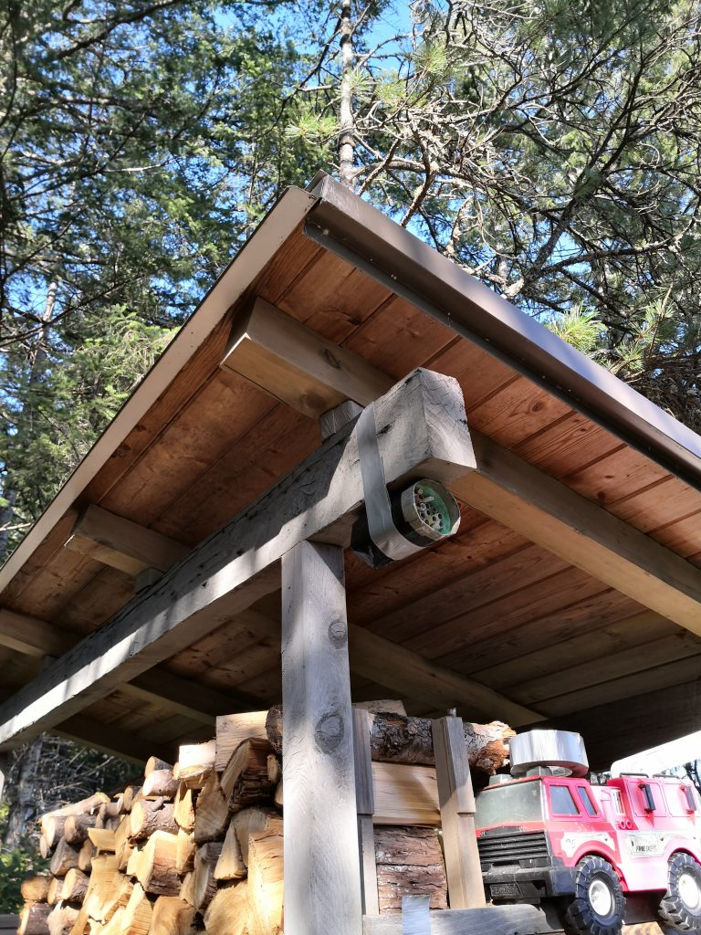 DIY mason bee house in a woodshed