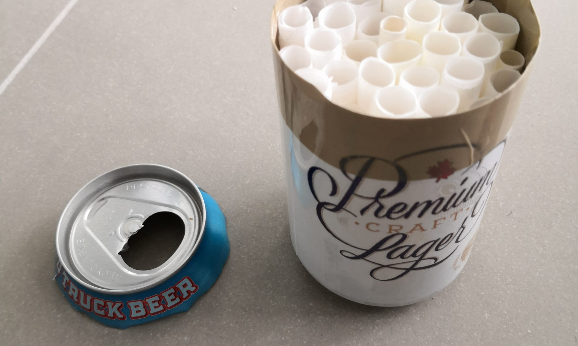 Photo of beer can-based mason bee house